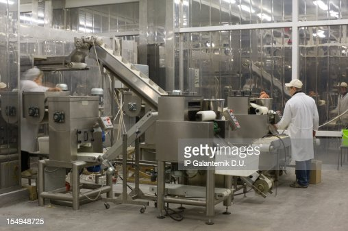 A complex production line with workers in a food factory