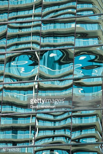 Complex reflection in a simple building : Stock Photo