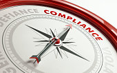 Arrow of a compass is pointing compliance text on the compass. Arrow, compliance text and the frame of compass are red in color. Horizontal composition qith copy space. Compliance concept.