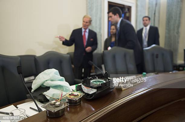 Components of a Takata airbag sit on a bench as Chairman of the US Senate Committee on Commerce Science and Transportation Bill Nelson DFlorida talks...