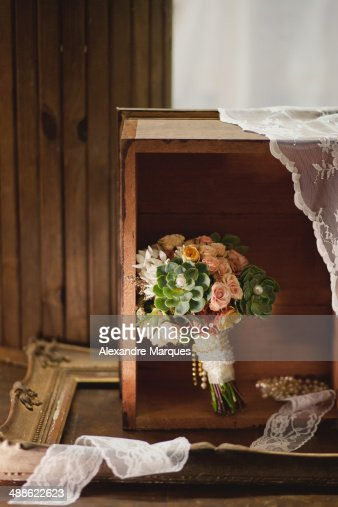Compose of suculent wedding bouquet with lace