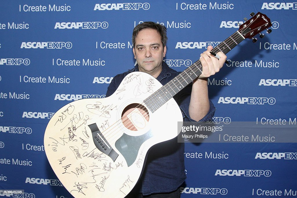 Composer Adam Schlesinger poses with a #StandWithSongwriters guitar, which will be presented in May to members of Congress to urge them to support reform of outdated music licensing laws, during the 2016 ASCAP 'I Create Music' EXPO on April 30, 2016 in Los Angeles, California.
