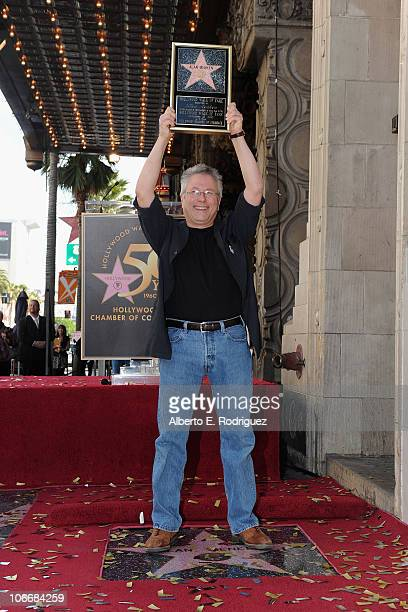 Composer Alan Menken attends a ceremony honring Alan Menken with a Star on The Hollywood Walk of Fame on November 10 2010 in Hollywood California