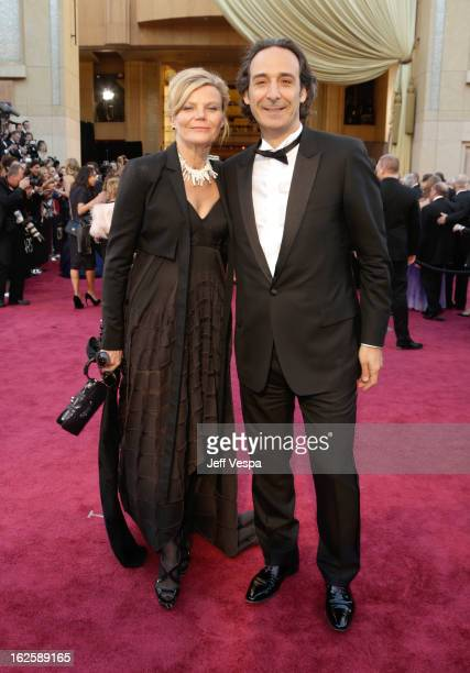 Composer Alexandre Desplat and Dominique Lemonnier arrive at the Oscars at Hollywood Highland Center on February 24 2013 in Hollywood California