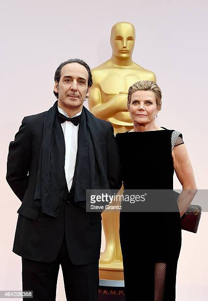 Composer Alexandre Desplat and film score producer Dominique Lemonnier attend the 87th Annual Academy Awards at Hollywood Highland Center on February...