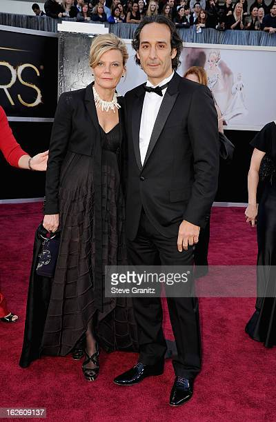 Composer Alexandre Desplat and guest arrive at the Oscars at Hollywood Highland Center on February 24 2013 in Hollywood California