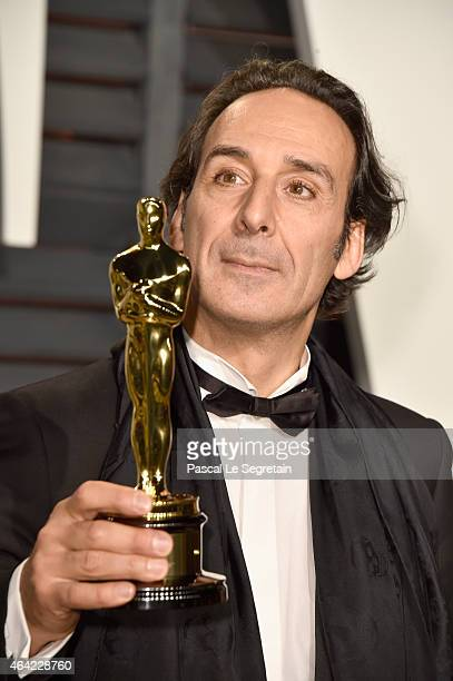 Composer Alexandre Desplat attends the 2015 Vanity Fair Oscar Party hosted by Graydon Carter at Wallis Annenberg Center for the Performing Arts on...