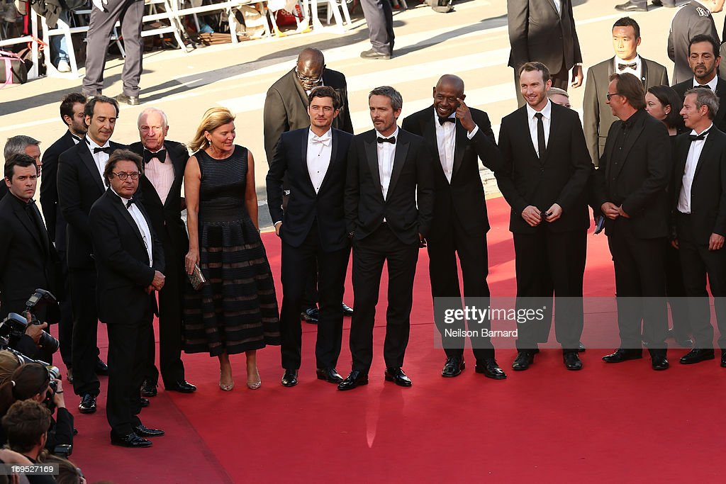 Composer Alexandre Desplat, guest, guest, actor Orlando Bloom, director Jerome Salle, actors Forest Whitaker and Conrad Kemp, producer Richard Granpierr and writer Caryl Ferey attend the 'Zulu' Premiere and Closing Ceremony during the 66th Annual Cannes Film Festival at the Palais des Festivals on May 26, 2013 in Cannes, France.