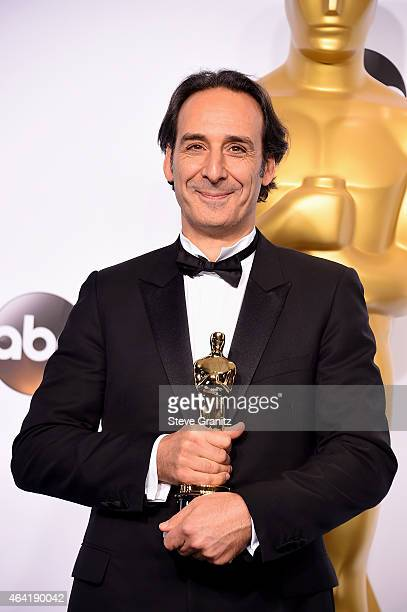 Composer Alexandre Desplat poses in the press room during the 87th Annual Academy Awards at Loews Hollywood Hotel on February 22 2015 in Hollywood...