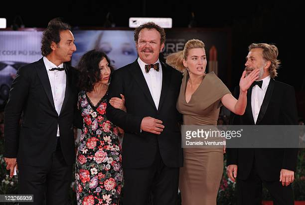 Composer Alexandre Desplat writer Yasmina Reza actors John C Reilly Kate Winslet and Christoph Waltz attend the 'Carnage' premiere during the 68th...