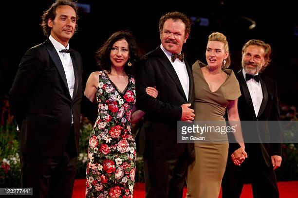 Composer Alexandre Desplat writer Yasmina Reza actors John C Reilly Kate Winslet and Christoph Waltz attend the premiere of 'Carnage' at Sala Grande...