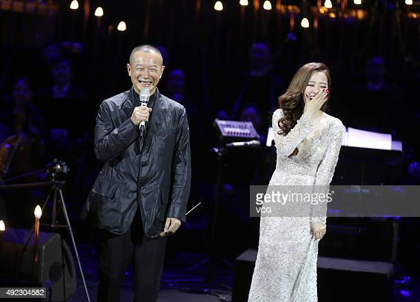 Composer and conductor Tan Dun singer Jane Zhang perform onstage during Jane Zhang's concert 'Jane Zhang and her friends' on October 11 2015 in...