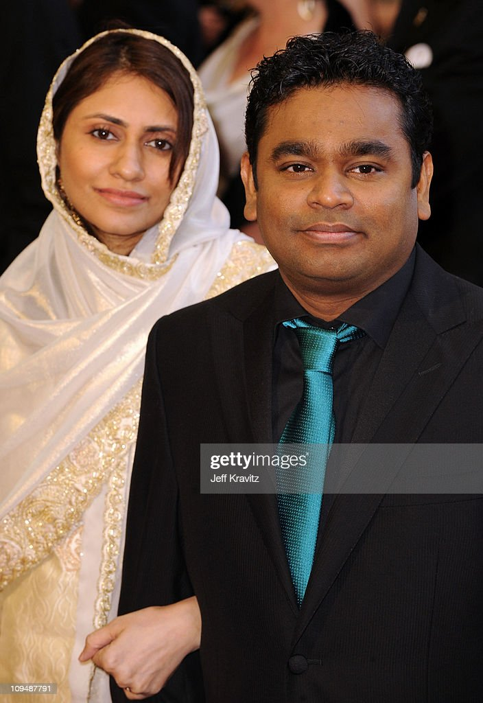 Composer <a gi-track='captionPersonalityLinkClicked' href=/galleries/search?phrase=A.R.+Rahman&family=editorial&specificpeople=1269970 ng-click='$event.stopPropagation()'>A.R. Rahman</a> (R) and guest arrive at the 83rd Annual Academy Awards held at the Kodak Theatre on February 27, 2011 in Los Angeles, California.