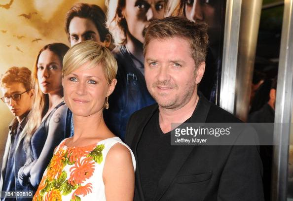 Composer Atli Orvarsson and wife Anna Orvarsson arrive at the Los Angeles premiere of 'The Mortal Instruments City Of Bones' at ArcLight Cinemas...