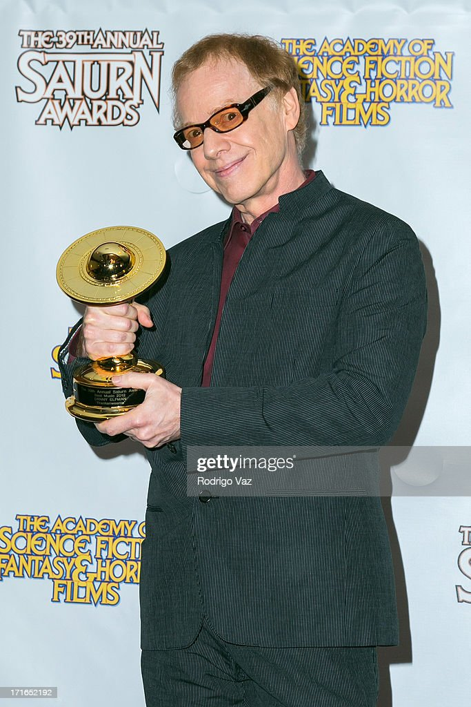 Composer <a gi-track='captionPersonalityLinkClicked' href=/galleries/search?phrase=Danny+Elfman&family=editorial&specificpeople=815887 ng-click='$event.stopPropagation()'>Danny Elfman</a> receives an award at the 39th Annual Saturn Awards at The Castaway on June 26, 2013 in Burbank, California.