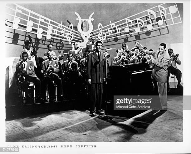 Composer Duke Ellington and his orchestra perform onstage with Herb Jeffries in 1941