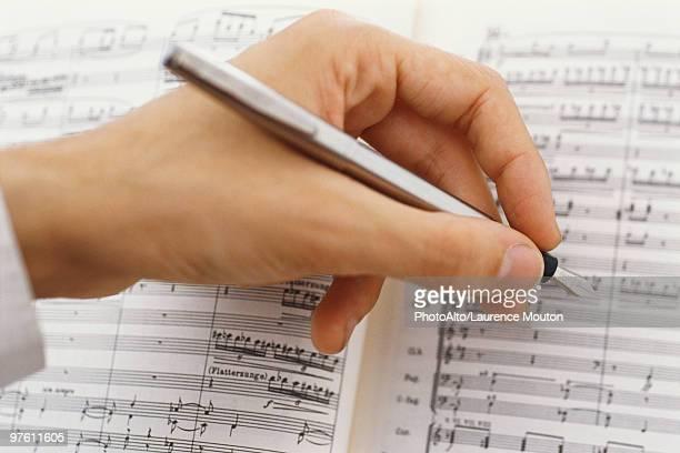 Composer editing musical score