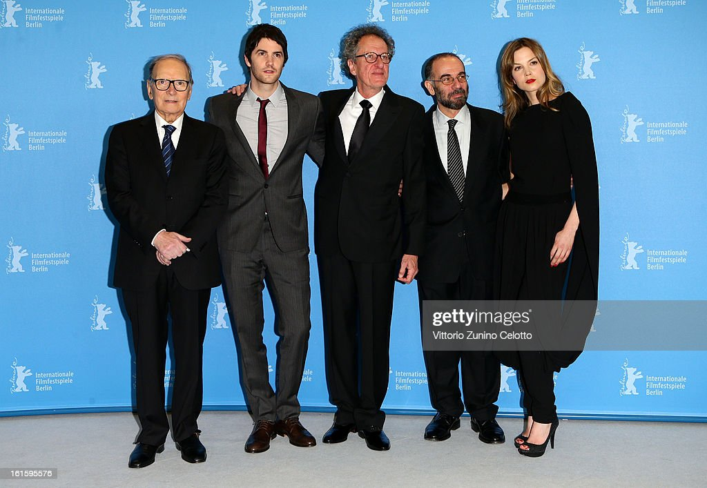 Composer <a gi-track='captionPersonalityLinkClicked' href=/galleries/search?phrase=Ennio+Morricone&family=editorial&specificpeople=677347 ng-click='$event.stopPropagation()'>Ennio Morricone</a>, actor <a gi-track='captionPersonalityLinkClicked' href=/galleries/search?phrase=Jim+Sturgess&family=editorial&specificpeople=4489740 ng-click='$event.stopPropagation()'>Jim Sturgess</a>, actor <a gi-track='captionPersonalityLinkClicked' href=/galleries/search?phrase=Geoffrey+Rush&family=editorial&specificpeople=201849 ng-click='$event.stopPropagation()'>Geoffrey Rush</a>, director <a gi-track='captionPersonalityLinkClicked' href=/galleries/search?phrase=Giuseppe+Tornatore&family=editorial&specificpeople=2761023 ng-click='$event.stopPropagation()'>Giuseppe Tornatore</a> and actress Sylvia Hoeks attend the 'The Best Offer' Photocall during the 63rd Berlinale International Film Festival at the Grand Hyatt Hotel on February 12, 2013 in Berlin, Germany.