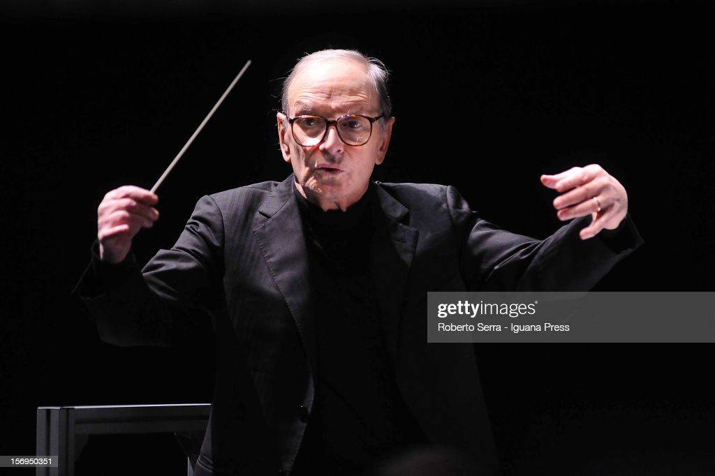 Composer <a gi-track='captionPersonalityLinkClicked' href=/galleries/search?phrase=Ennio+Morricone&family=editorial&specificpeople=677347 ng-click='$event.stopPropagation()'>Ennio Morricone</a> performs at Unipol Arena on November 24, 2012 in Bologna, Italy.