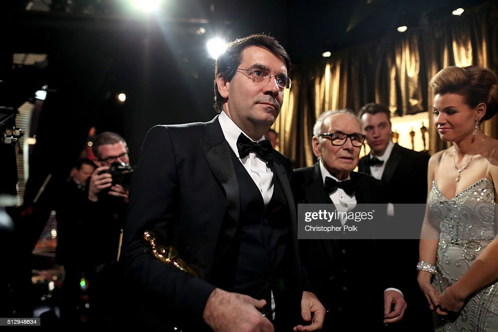 Composer <a gi-track='captionPersonalityLinkClicked' href=/galleries/search?phrase=Ennio+Morricone&family=editorial&specificpeople=677347 ng-click='$event.stopPropagation()'>Ennio Morricone</a> (2nd from left) winner of the Best Original Score award for ''The Hateful Eight' backstage at the 88th Annual Academy Awards at Dolby Theatre on February 28, 2016 in Hollywood, California.