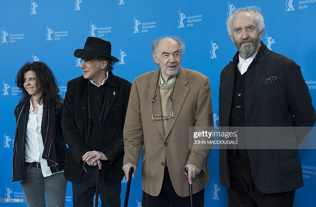 Composer Florencia di Concilio from Uruguay, US cinematographer Edward Lachman, Dutch director and producer George Sluizer and Welsh actor Jonathan Pryce pose during a photocall for the film 'Dark Blood' presented in Competition at the 63rd Berlin International Film Festival in Berlin on February 14, 2013. AFP PHOTO / JOHN MACDOUGALL