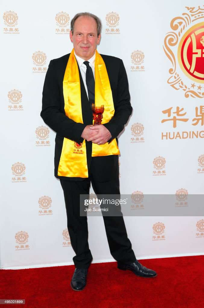 Composer <a gi-track='captionPersonalityLinkClicked' href=/galleries/search?phrase=Hans+Zimmer&family=editorial&specificpeople=243005 ng-click='$event.stopPropagation()'>Hans Zimmer</a> poses with the Lifetime Achievement Award in the press room during the Huading Film Awards on June 1, 2014 at Ricardo Montalban Theatre in Los Angeles, California. Huading Film Awards is China's #1 Film awards, in the U.S. for the first time.