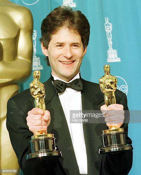 Composer James Horner holds his two Oscars for Best Original Song for 'My Heart Will Go On' and Best Dramatic Score for Titanic at the 70th Annual...