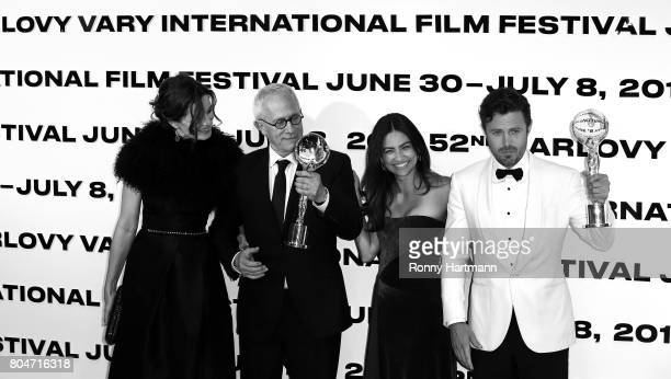 US composer James Newton Howard and his wife Sophie and US actor Casey Affleck and his girlfriend Floriana Lima attend the opening ceremony of the...