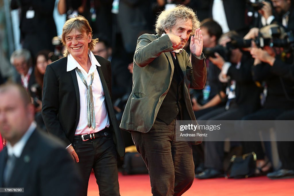 Composer Jean-Louis Aubert and director <a gi-track='captionPersonalityLinkClicked' href=/galleries/search?phrase=Philippe+Garrel&family=editorial&specificpeople=2256586 ng-click='$event.stopPropagation()'>Philippe Garrel</a> attend the 'Jealousy' Premiere during the 70th Venice International Film Festival at the Palazzo del Cinema on September 5, 2013 in Venice, Italy.