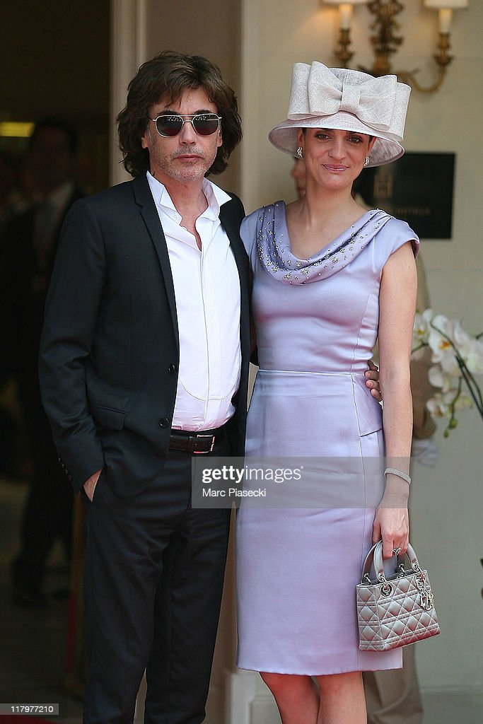Composer Jean-Michel Jarre and his daughter Emilie are sighted at the 'Hermitage' hotel to attend the Royal Wedding of <a gi-track='captionPersonalityLinkClicked' href=/galleries/search?phrase=Prince+Albert+II+of+Monaco&family=editorial&specificpeople=201707 ng-click='$event.stopPropagation()'>Prince Albert II of Monaco</a> to <a gi-track='captionPersonalityLinkClicked' href=/galleries/search?phrase=Charlene+-+Princess+of+Monaco&family=editorial&specificpeople=726115 ng-click='$event.stopPropagation()'>Charlene</a> Wittstock in the main courtyard at on July 2, 2011 in Monaco, Monaco.