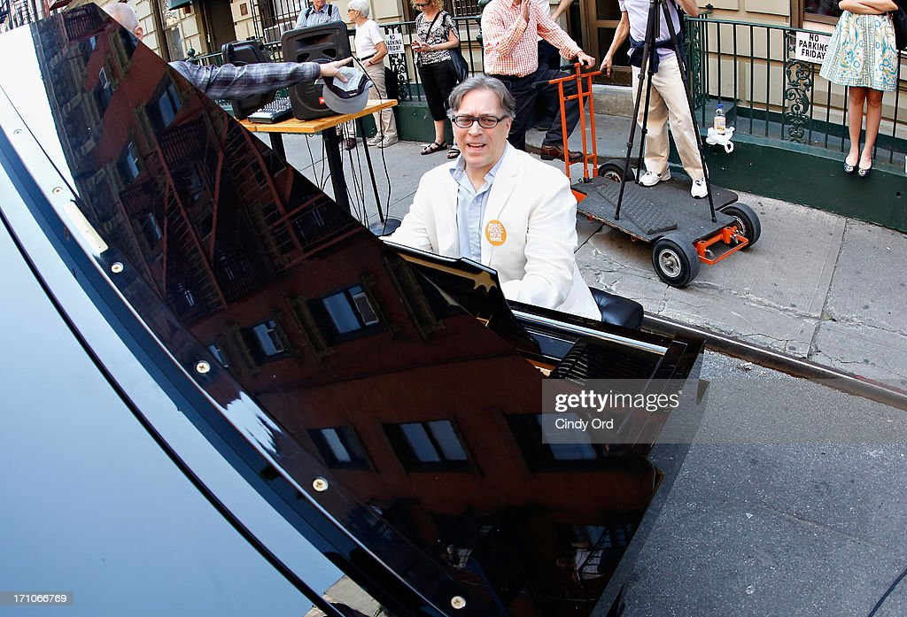 Composer Jed Distler plays the piano during The National Association Of Music Merchants (NAMM) NAMM Presents First Ever National Music Day And Make Music NY at Cornelia Cafe on June 21, 2013 in New York City. 175 keyboards play together breaking Guinness world record on National Music Day as part Of Make Music NY. Keyboards to be donated to NYC Public Schools by Yamaha and Viacom following the event.
