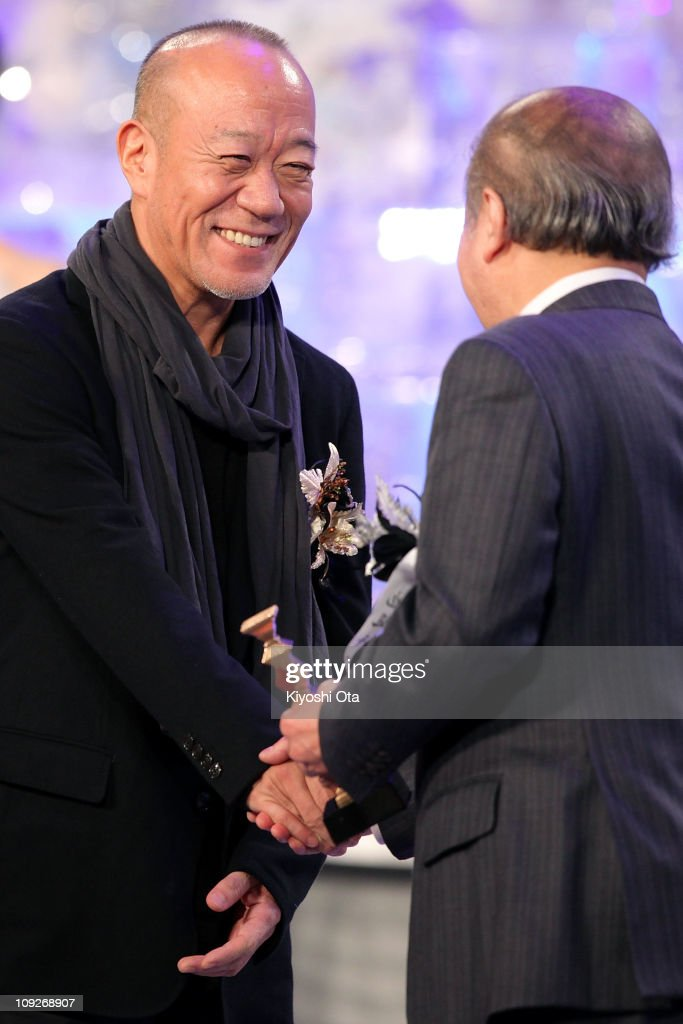 Composer Joe Hisaishi accepts the award for Best Music for 'Akunin' (Villain) on stage during the 34th Japan Academy Awards at Grand Prince Hotel New Takanawa on February 18, 2011 in Tokyo, Japan.