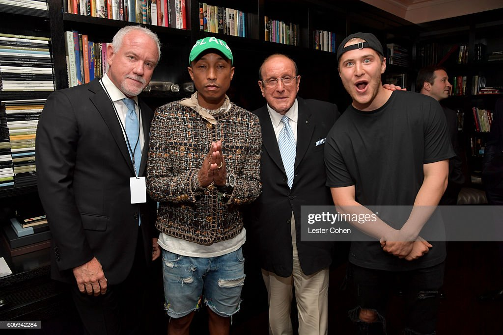 Composer John Debney, Singer-songwriter Pharrell Williams, Record Producer Clive Davis and Singer Mike Posner attend Songs Of Hope at a private residence on September 15, 2016 in Brentwood, California.