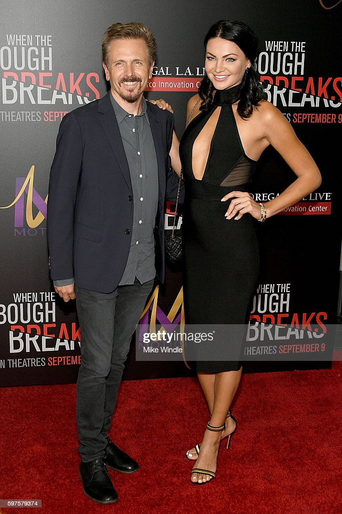 Composer John Frizzell and model Anna Sizykh attend the premiere of Sony Pictures Releasing's 'When The Bough Breaks' at Regal LA Live Stadium 14 on...
