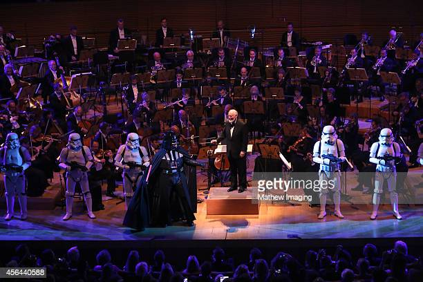 Composer John Williams is seen onstage with a Darth Vader character and the Official Imperial Stormtroopers at Los Angeles Philharmonic's Walt Disney...