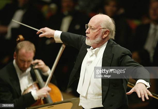Composer John Williams performs on stage at the Walt Disney Concert Hall opening gala day three of three October 25 2003 in Los Angeles California...
