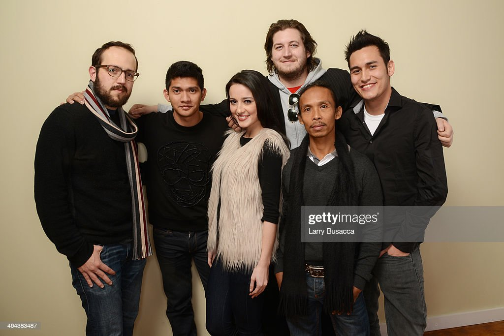 Composer Joseph Trapanese, actors Iko Uwais and Julie Estelle, filmmaker Gareth Evans, and actors Yayan Ruhian and Arifin Putra pose for a portrait during the 2014 Sundance Film Festival at the Getty Images Portrait Studio at the Village At The Lift Presented By McDonald's McCafe on January 22, 2014 in Park City, Utah.