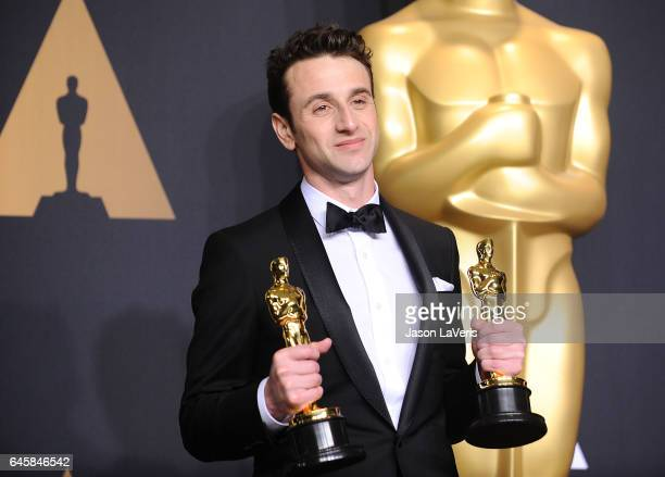 Composer Justin Hurwitz poses in the press room at the 89th annual Academy Awards at Hollywood Highland Center on February 26 2017 in Hollywood...