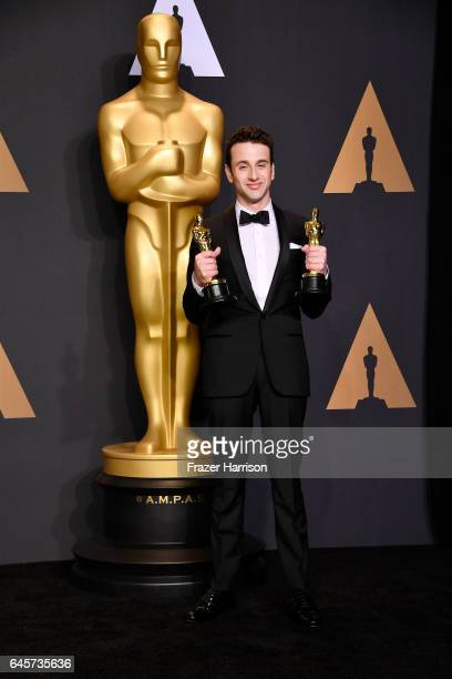 Composer Justin Hurwitz winner of Best Original Score and Best Original Song for 'La La Land' poses in the press room during the 89th Annual Academy...