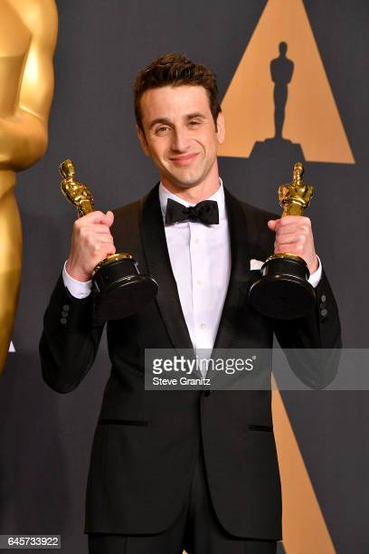 Composer Justin Hurwitz winner of the awards for Music and Music for 'La La Land' poses in the press room during the 89th Annual Academy Awards at...