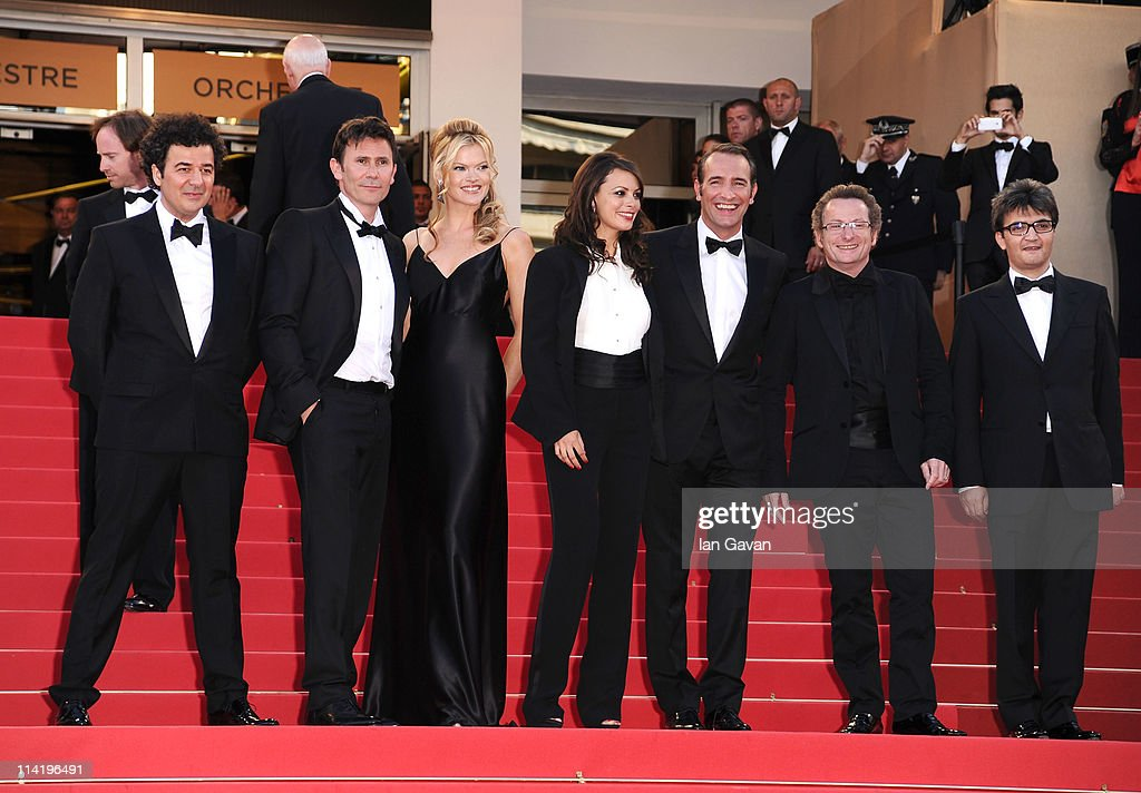 Composer Ludovic Bource, Director Michel Hazanavicius, actresses Missi Pyle,Berenice Bejo, actor Jean Dujardin, guest and producer Thomas Langmann attend 'The Artist' premiere at the Palais des Festivals during the 64th Annual Cannes Film Festival on May 15, 2011 in Cannes, France.