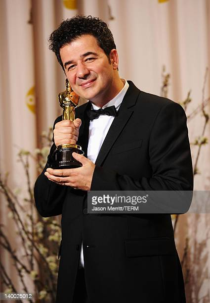 Composer Ludovic Bource winner of the Best Original Score Award for 'The Artist' poses in the press room at the 84th Annual Academy Awards held at...