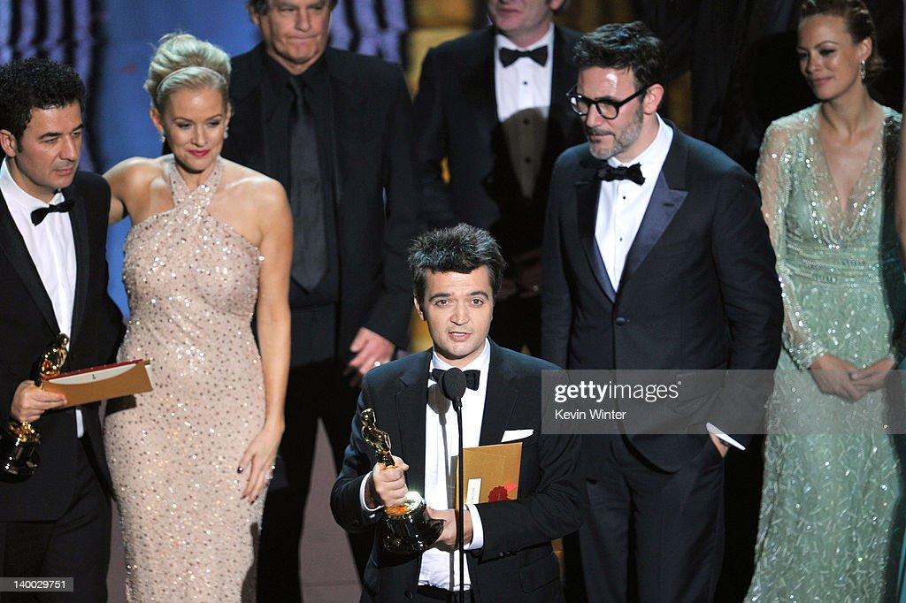 Composer Ludovic Bourceactress Penelope Ann Miller producer Thomas Langmann director Michel Hazanavicius and actress Berenice Bejo accept the Best...