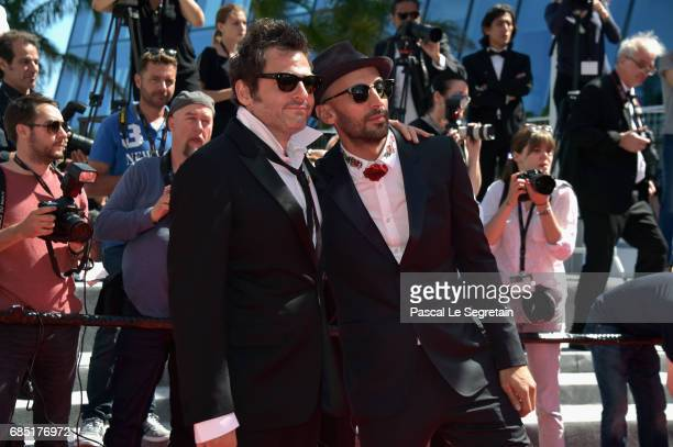 Composer Matthieu Chedid and director JR attend the 'Faces Places ' screening during the 70th annual Cannes Film Festival at Palais des Festivals on...