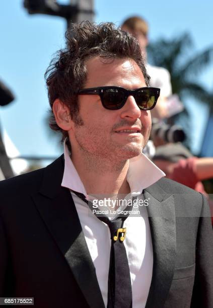 Composer Matthieu Chedid attends the 'Faces Places ' screening during the 70th annual Cannes Film Festival at Palais des Festivals on May 19 2017 in...