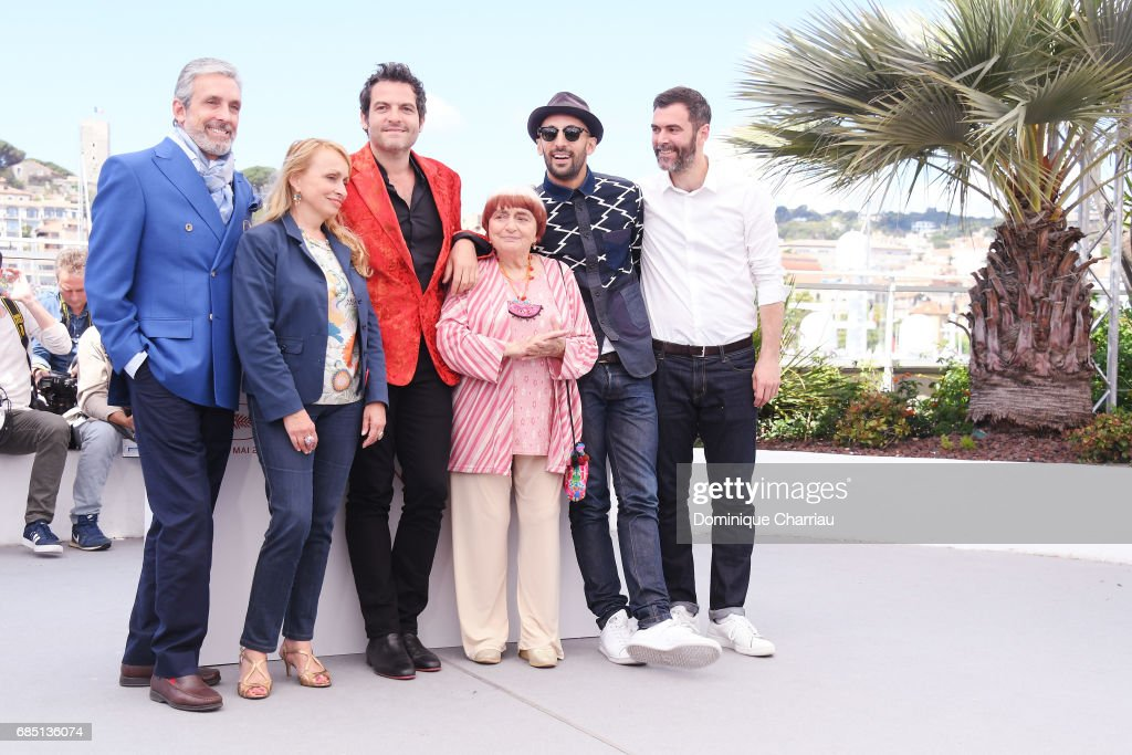 JR, composer Matthieu Chedid, director Agnes Varda and members of the cas pose as they attend 'Faces, Places (Visages, Villages)' photocall during the 70th annual Cannes Film Festival at Palais des Festivals on May 19, 2017 in Cannes, France.