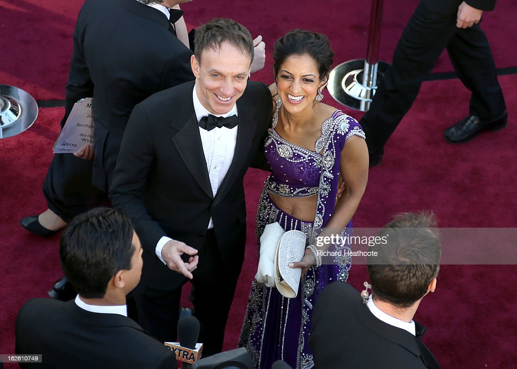 Composer Mychael Danna and wife Aparna arrives at the Oscars at Hollywood & Highland Center on February 24, 2013 in Hollywood, California.