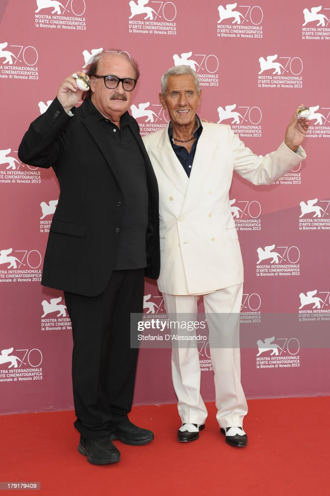 Composer Pino Donaggio and actor Enzo Staiola attend 'Non Eravamo Solo... Ladri di Biciclette. Il Neorealismo' Premiere during the 70th Venice International Film Festival at Sala Perla on September 1, 2013 in Venice, Italy.