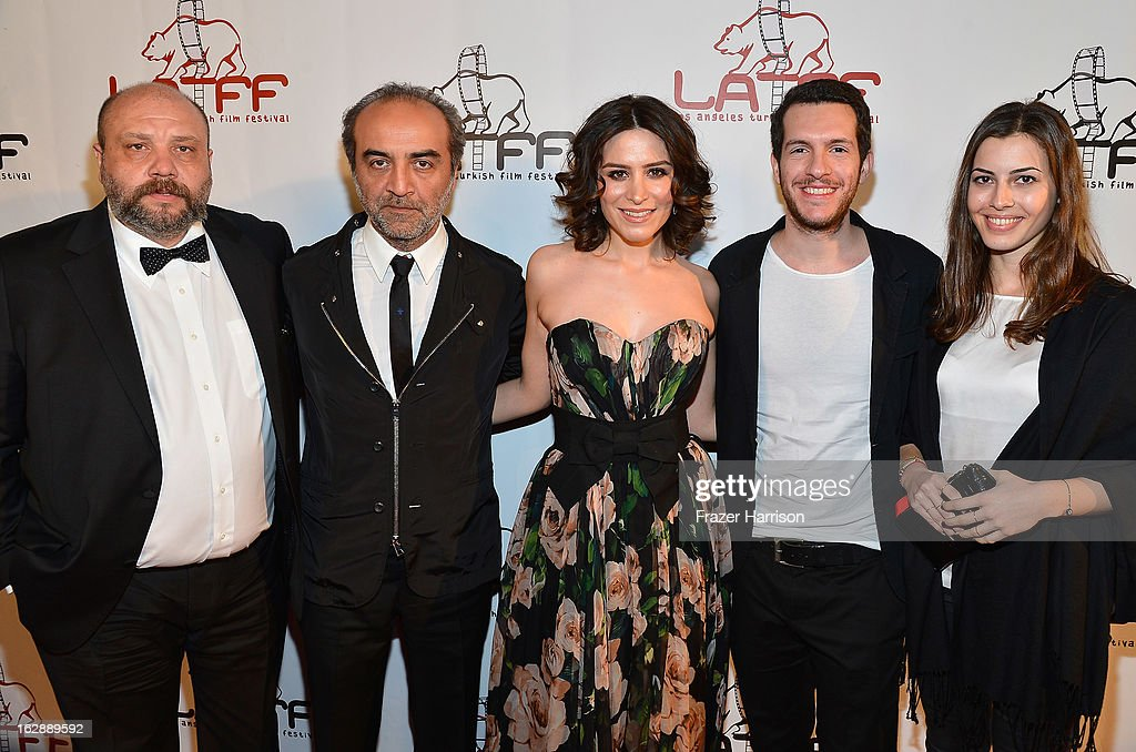 Composer Rahman Altin, Filmmaker/actor Yilmaz Erdogan Actress Belçim Bilgin Actor/writer Aksel Bonfil, producer Ilkyaz Kocatepe arrives at the 2013 Los Angeles Turkish Film Festival Opening Night Premiere Of 'The Butterfly's Dream'at the Egyptian Theatre on February 28, 2013 in Hollywood, California.