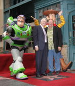 Composer Randy Newman and John Lasseter attend the Hollywood Walk Of Fame star ceremony honoring him on June 2 2010 in Hollywood California